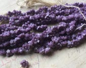 25 Tiny purple vintage czech glass flower beads