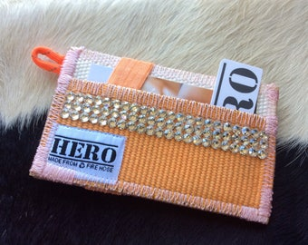 Orange-Wallet made from decommissioned fire hose and embellished with Swarovski crystals!