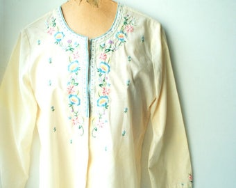 Peasant vintage 70s, antique white , polyester bland, long sleeve blouse with a  pastel hand embroidery. Made by Daffodil.Medium.
