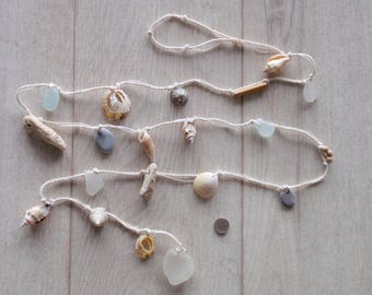 "English seaglass garland,holed shells, beads, pebbles,driftwood ,sea glass white finish 64""long"