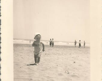 Vintage 1950/50s French black & white  photography baby running on Cannes beach