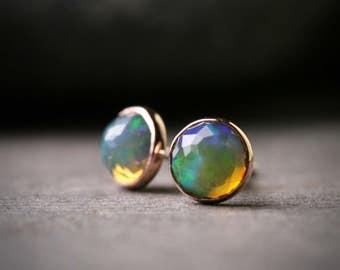 Bezel set 5mm faceted opal stud earrings set in solid 14k rose gold