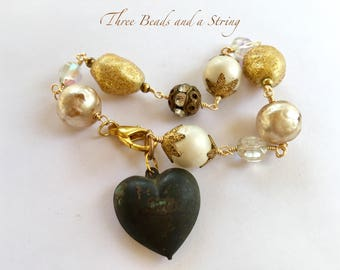 One of a kind wired Vintage Beads and Puffy Heart Bracelet