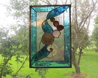 Seashells in a ribbon of aqua stained glass