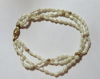 SALE 1970s Triple Strand Rice Pearl Bracelet, 14K Y Gold Filigree clasp, 6 inches long, free US first class shipping on vintage