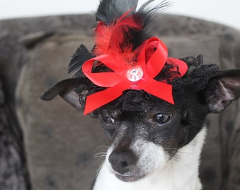 Cute red color  hat with  red and black color    feather and red  color bow  for dog or cat