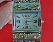 """Silver & gold tone hinged bracelet watch w 1.5"""" face with filigree style band, great condition   Works great, Fresh battery just installed"""
