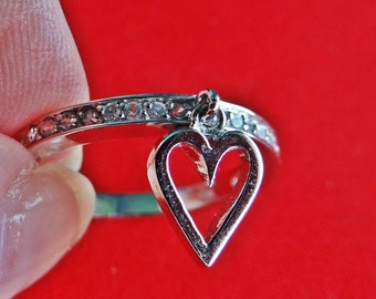 Vintage rhinestone silver tone ring with dangle heart charm in great condition, appears unworn, sizes 6 & 7 available