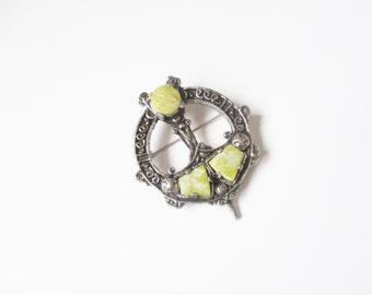 Filigree Miracle brooch: Mid century filigree celtic silver tone, pale green moss agate kilt pin style Victoriana pin brooch, signed Miracle