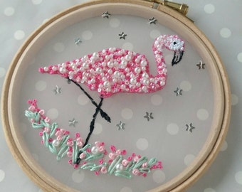 Flamingo Freehand Embroidery on voile with Frenchknots, beads & sequins for extra sparkle. Framed in hoop with ribbon hanging loop.
