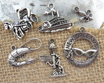 6 New Orleans or Mardi Gras Theme Assorted Charms -Each One Different in Antique Silver - Fleur de Lis, River Boat, Shrimp, Horse & Buggy