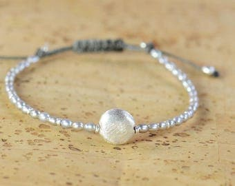 Grey pearls and sterling silver beaded bracelet.