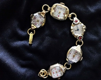 Old Vintage Art Deco Gold Watch Face Bracelet All With Clear and Ruby Colored Stones Steampunk Altered Art Recycled