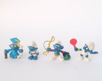 Lot of 4 vintage Smurf Smurfs figurines Graduate Karate circus animal lion tamer tennis player