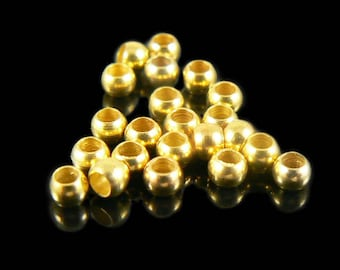 1.5mm inside diameter gold plated, smooth crimp beads, 100 pcs.  Must-have finding, staple, end, use with wire.