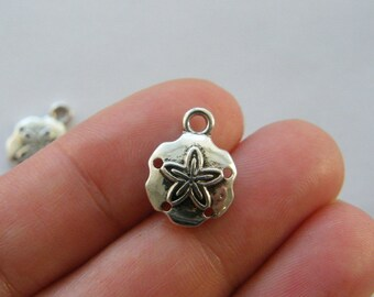 6 Sand dollar charms antique silver tone FF353