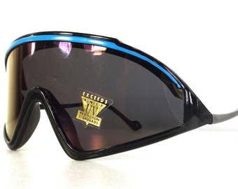 vintage 80s deadstock ski shield razor blade style sunglasses oversized wrap around revo aqua blue plastic lightweight black NOS b101