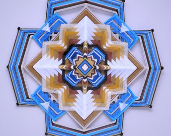 Sacred Space, a 24 inch   Ojo de Dios, by Jay Mohler, in stock, ready to ship.