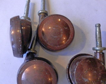 set of 4 vintage sheppard antique copper hard rim casters