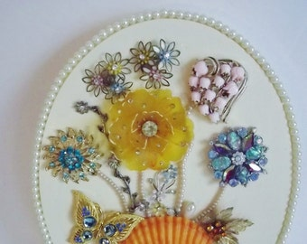 Seashell and Jeweled Brooch Floral Plaque