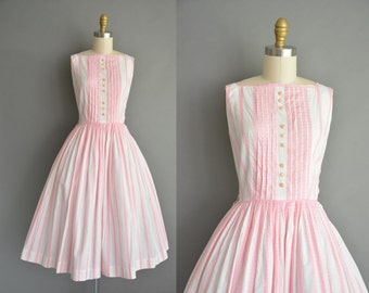 Pink cotton stripe vintage 1950s dress with a full skirt. vintage 1950s dress
