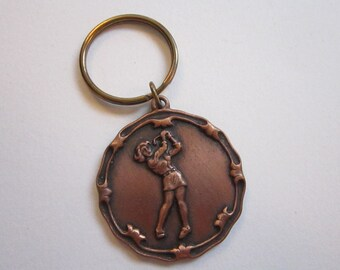 vintage key chain - woman golfer - Pinewood 1993 - 1.5 inches