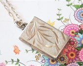 Vintage sterling silver locket. Rectangular locket on a silver chain.