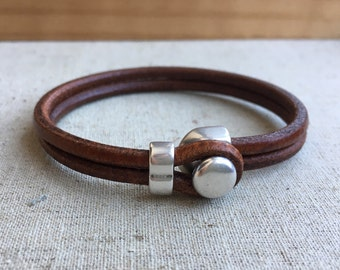LEATHER CUFF bracelet. BROWN leather with silver half cuff button clasp.