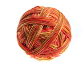 Tangy Variegated and Sprinkle Dyed Fingering Weight Sock Yarn in 'Mexican Spice' - a spicey combination of ochre, orange, red, brown