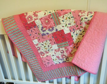 Baby Girl Quilt, pinks with a splash of purple.
