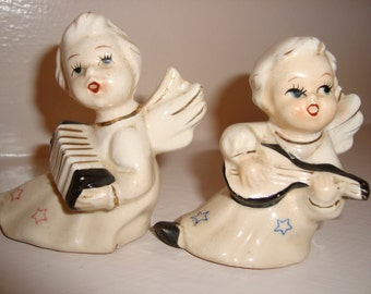 Adorable pair of musical angels