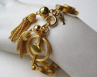 Vintage 50s Crown Trifari Gold Panel Link Tassel Bracelet