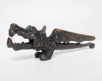 Sale off 20% vintage metal Dragon, nut cracker.