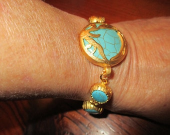Magnificent Genuine TURQUOISE Focal w/22K Gold Fretwork Bezel Setting & 6 Turquoise Gold Links W/Embossed Toggle Bracelet