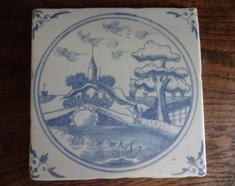 Vintage Italian Delft Style large wall tile blue white sold individually aged look reproduction lake bridge boats c 1980-90's / English Shop