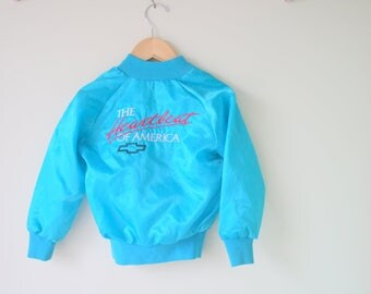 1980s The Heartbeat of America Jacket.size xs kids. colorful. bright. retro. teal. rainbow. 1980s. 1990s. rad. fun. hipster. unisex. swishy.