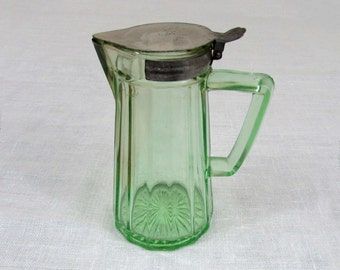 "Antique Green Glass Syrup Pitcher 5.5"" tall - D handle- lid has 1916 patent date"