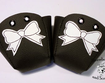 Black leather Roller Derby skate toe guards with Bows