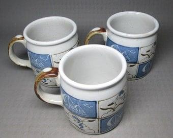 Otagiri pottery three mugs , boats and seagulls , colors are matte