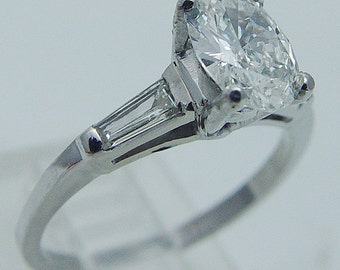 Platinum VVS-F .75ct Oval Diamond plus .22ct Tapered diamonds Engagement Ring