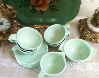 Boonton plastic mugs saucers creamer and sugar bowl 11 piece set mid century melmac set light green 1950s kitchen glamping camping ware