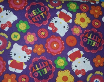 Hello kitty licensed by Sanrio purple background with hello kitty, flowers, and buttons rare oop