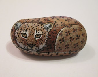 Leopard hand painted on a stone - pet rock - by Ann Kelly