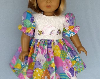 18 inch doll Easter dress and hair clip.  Fits American Girl dolls. Easter print with white contrast and embroidered Easter bunny.