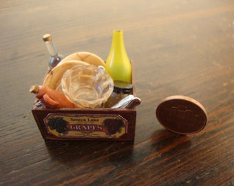 dollhouse miniatures. wooden crate in mahogany wood  with old dishware