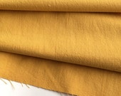 japanese linen blended cotton fabric. washer finish fabric. medium weight fabric. 105cm (41in) wide. sold by 50cm (19in) long. mustard