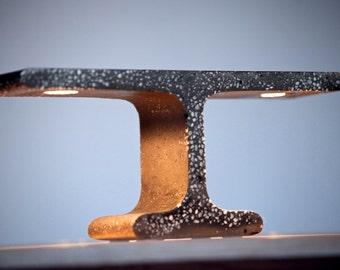 "SALE**Extrude ""T"" table lamp - black concrete w/marble crush."