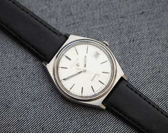 Vintage Pulsar Quartz watch with date function black leather strap and silver brushed dial
