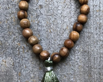 Olive wood and moss green tassel stretch stacking bracelet