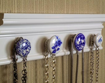 """White necklace rack. This jewelry organizer wall hanging features 4 blue and white ceramic knobs total /12 """" jewelry storage"""
